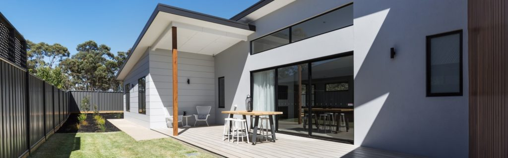 Outdoor entertaining deck and lawn of a contemporary new Australian home